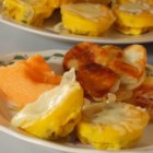 Healthy Egg Muffins - Eggs, cheese, and crumbled vegetarian burger patties are baked in muffin cups for a breakfast item to grab and go.