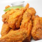 Easy Restaurant-Style Buffalo Chicken Wings - Restaurant-style buffalo chicken wings can be ready in less than an hour and are a spicy appetizer perfect for parties.