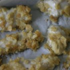 Crunchy Chicken Fingers - Chicken strips coated with an egg/milk mixture and tortilla chip crumbs, then baked.
