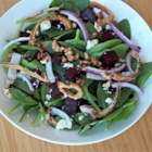 Spinach and Beet Salad - Spinach and roasted beets are tossed with candied walnuts, goat cheese, and a homemade vinaigrette for a lovely summer salad perfect for weeknights.
