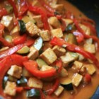 Lime-Curry Tofu Stir-Fry - This is a quick and tasty sweet and sour dish. Tofu is stir-fried with zucchini and red bell pepper, then simmered in a coconut curry sauce, and finished off with chopped fresh basil.