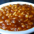 Down Home Baked Beans - Chili sauce is the secret ingredient in these beans baked with bacon, onion and brown sugar.  This recipe can also be prepared in a slow cooker, if desired.