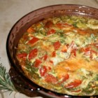 Quiche with Kale, Tomato, and Leek - A simple and healthy breakfast quiche with leeks, kale, and cherry tomatoes is seasoned with fresh rosemary.