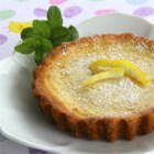 Sweet and Simple Lemon Tart - Simple ingredients like butter, eggs, and fresh lemon give this lovely tart its fresh, light flavor.