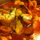 Uncle Dank's Gumbo - Dis iz a terrific gumbo recipe, if'n you close your eyes, you'll swear Mama is makin'it fer ya. Feel free to substitute crawdads fer de shrimp.  File is optional and is always added off of the heat. Add rice to the center of a large soup bowl, add gumbo.  Deeelicious!!!