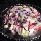 Fruit Salad for Easter Sunday - A simple and beautiful fruit salad with rainbow colors of strawberries, kiwi fruit, pineapple, and blueberries gets the easiest dressing ever, lemon yogurt. Kids will love it.
