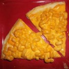 Easy Mac and Cheese Pizza - This quick and easy macaroni and cheese pizza combines the greatness of pizza with the cheesy goodness of mac and cheese.