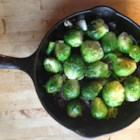 Pan Fried Brussels Sprouts - Put away your sad memories of boiled Brussels sprouts. Pan fry them in hot olive oil with garlic and onion, and they turn golden brown, with crispy edges and a sweet, nutty flavor that will become addictive.