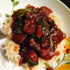 Mongolian Beef and Spring Onions - Thin-sliced beef flank steak gets a quick fry in hot oil, then is simmered in a sweet soy-based sauce with fresh green onions for a dish that's like eating out at home.