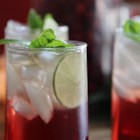 Cranberry Punch - Cranberry-apple juice mixed with ginger ale and garnished with slices of lime and sprigs of mint.