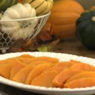 Maple Glazed Butternut Squash - Tender slices of butternut squash are topped with a maple and rum glaze creating a colorful and rich side dish for the Thanksgiving table.