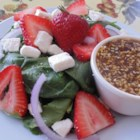 Spinach and Strawberry Salad with Feta Cheese - Spinach salad with strawberries is a summertime natural. This version adds feta cheese and provides a homemade balsamic vinaigrette.