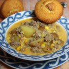 Quick Spicy Sausage Corn Chowder - Sausage and corn are simmered in a spicy broth for a quick weeknight chowder the whole family will enjoy.