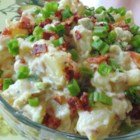 Caesar Potato Salad - Warm potato salad made with bacon and Caesar salad dressing is a delightful dish to prepare on warm summer days.