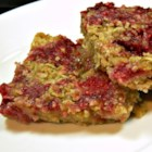 Raspberry Applesauce Squares - A sweet raspberry and applesauce filling surrounded by buttery oats makes a delightful snack for tea time with this quick and easy recipe.