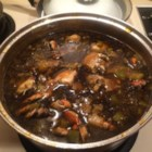 Seafood Gumbo - A recipe for seafood gumbo that contains oysters, crab, and shrimp in a spicy thick broth made with spices, aromatic vegetables, and a dark roux.