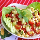 Easy Cherry Tomato Corn Salad - In the summer use fresh corn corn off the cob and tomatoes from your garden in this simple and delicious tomato corn salad.