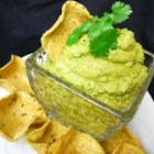 Cilantro Jalapeno Hummus - Cilantro and a jalapeno pepper take this hummus recipe to a new spicy and colorful level. Enjoy with pita or tortilla chips.