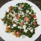 Kale and Chard Supreme - Kale and chard are pan-fried with ham and pineapple and then tossed with feta cheese, almonds, and dried cranberries for a colorfully delicious side dish.