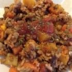 Lentil Rice and Veggie Bake - Lentils, rice, tomato sauce, herbs, and vegetables yield a wonderful meal for vegans and non-vegans alike.