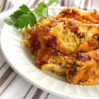 Kugeli Comfort Potato Dish - Shredded potatoes, Cheddar cheese, bacon, and sun-dried tomatoes are baked into a rich comfort food perfect for brunch or as a dinner side dish.