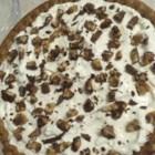 Easy Cheesecake Pie - This creamy cheesecake is super easy to whip up. Just mix softened cream cheese, whipped topping, vanilla and sugar until smooth. Spoon the mixture into a ready-made crust, chill and serve. Shaved chocolate looks and tastes great sprinkled over the top.