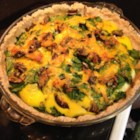 Quick Quiche - Refrigerated crescent dough makes a quick and tasty crust for this cheese, spinach, and red pepper filled quiche.