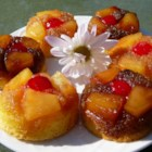 Pineapple Upside-Down Cupcakes - Enjoy all the tasty goodness of pineapple upside-down cake in cupcake form with this quick and easy recipe!