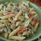 Creamy Penne Pasta Primavera - Creamy pasta primavera made with asparagus, carrots, and tomatoes is a colorful, quick and easy, weeknight meal.