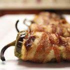 Bacon-Wrapped Jalapeno Poppers - Jalapeno peppers are stuffed with a blend of cream cheese and Cheddar cheese in this crowd-pleasing, bacon-wrapped appetizer.