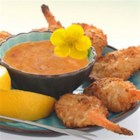 Baked Coconut Shrimp with Spicy Dipping - Butterflied shrimp dipped in coconut milk and coated with a panko and flaked coconut are baked until golden brown  and served with a zesty orange-mustard dipping sauce.