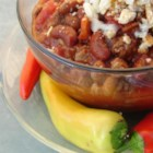 Swink's Chili - Baked beans, tomato soup and diced tomatoes with green chiles are the unique ingredients in this ground beef slow-cooker chili.