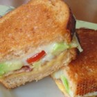 Alexa's Gourmet Grilled Cheese - Avocado, tomato slices, and Swiss cheese are cooked between marbled rye bread for a gourmet grilled cheese sandwich.