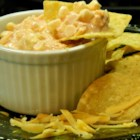 Corn Salsa Dip - Corn and salsa are folded with sour cream and Cheddar cheese creating a simple and crowd-pleasing corn salsa dip.