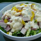 Maurice Salad - This hearty and wonderful salad is made with lots of turkey, cheese, ham, and pickles, topped with a fabulous spiced mayonnaise dressing.