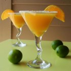 Mango Orange Slush - Enjoy this mango orange slush with a touch of ginger and lime on a hot summer day.