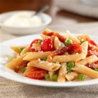 Barilla PLUS(R) Penne with Pancetta, Grape Tomatoes, Peas, and Romano Cheese - Penne pasta is tossed with fresh grape tomatoes, green peas and pancetta for a colourful dish made with simple ingredients full of flavour.