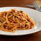 Barilla Whole Grain Spaghetti with Tuscan Sauce - This traditional Italian spaghetti dish from Tuscany is a delicious combination of ground beef, pork, San Marzano tomatoes, and fresh herbs in a red wine sauce.