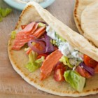 Grilled Salmon Greek Pitas - Tuck grilled salmon, lettuce, and onion inside a pita, and pair with a yogurt dip for a refreshing summertime lunch.