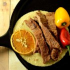 Citrus Asada Fajitas - Carne asada marinated in a chipotle-orange sauce is easy to prepare for Cinco de Mayo. Serve on homemade tortillas!