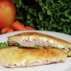 Turkey and Feta Grilled Sandwich - Simply put, this recipe delivers a grilled cheese sandwich made with feta cheese, turkey, lettuce, and Italian salad dressing.