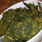 Cheesy Kale Chips - Crispy, oven-baked kale chips seasoned with nutritional yeast for a cheese-like flavor.
