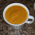 Butternut Squash-Sweet Potato Ginger Bisque - Butternut squash and sweet potatoes blend with ginger, garlic, and onion in this creamy, pureed soup that's ideal for warming body and soul in wintertime.