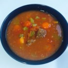 Portuguese Soup - Smoked sausage, cabbage, potatoes and kidney beans are cooked with ketchup and beef broth in this soup.