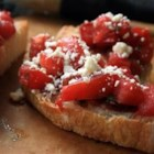 Double Tomato Bruschetta - Bruschetta is a traditional Italian item in which small slices of bread are topped with such things as tomato, basil, and mozzarella cheese, as is the case in this delightful recipe.