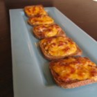 Rye Rounds - A quick spell under the broiler melts cheddar cheese and mayonnaise over crunchy bits of onion and bacon.