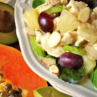 Overnight Chicken and Fruit Salad - Cooked chicken, red grapes, slivered almonds, and pineapple chunks make a lovely savory-sweet salad that's dressed with a mild curry mayonnaise. Papaya and avocado slices add color and flavor. Refrigerate overnight for the best flavor.