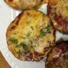 Flourless Eggplant Pizza - Using eggplant as the crust, these mini-pizzas can be topped with whatever you like on your pizza.