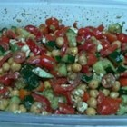 Easy Chickpea Salad - A simple, homemade balsamic vinaigrette dresses this chickpea salad with tomatoes, cucumber, bell pepper, and feta cheese.