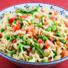 Pasta Salad I - This colorful pasta salad features a medley of crunchy veggies! Combine pasta with broccoli, cauliflower, carrots, celery, bell peppers, mushrooms and fiery sweet red onions. A sweetened mayonnaise and vinegar binds the salad.